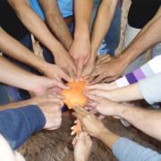 Team touching aim1 180x180 - Soziokratische Prinzipien in politischer Partizipation
